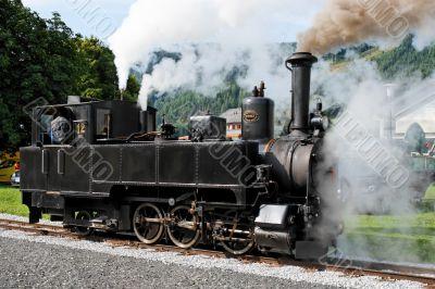 Historical steam engine on tracks