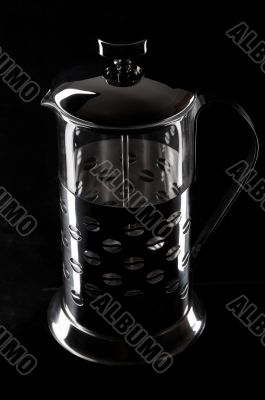 French-press in black background