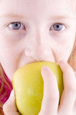 close up of a girl biting an apple