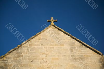 stone cross over triangle covering