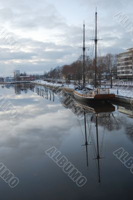 Sailing Boat and Reflection in Water.