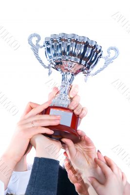 prize-winning cup in hands of a command