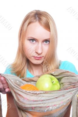 The girl  gives fruit