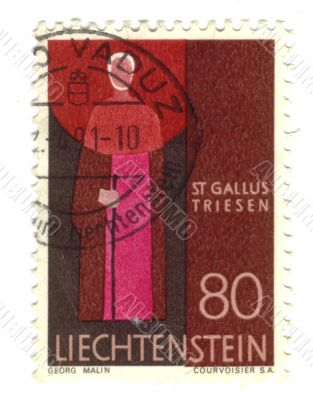 Old stamp from Liechtenstein with priest