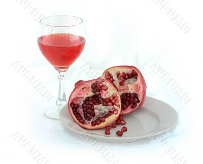 Still-life with a glass of wine and pomegranate
