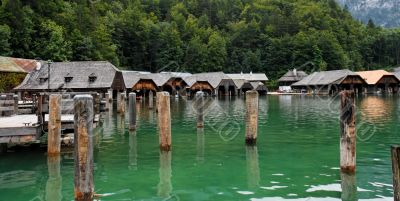 Boat houses and mooring posts on lake