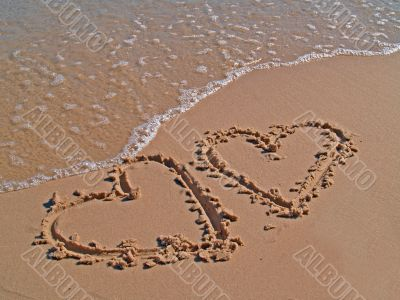 Hearts drawn on sand