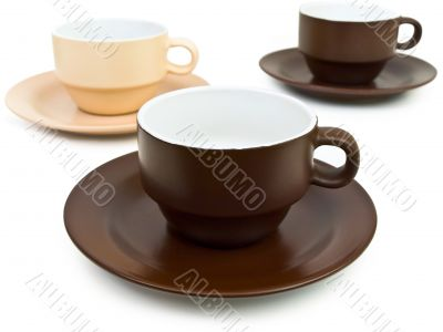 brown and beige coffee cups