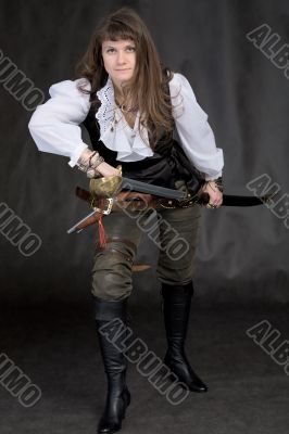 The girl - pirate with a sabre in hands