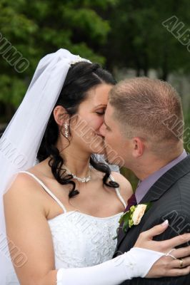 Bride and groom are kissing