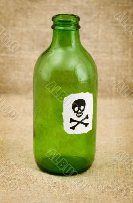 Bottle with sticker - skull and crossbones
