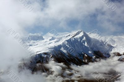 Peak surrounded by clouds. Swiss Alps