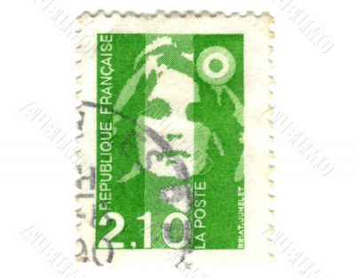 Old green french stamp with woman head