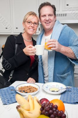 Businesswoman with Husband In Kitchen