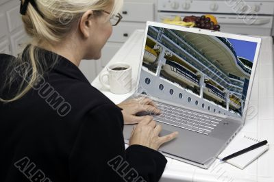 Woman In Kitchen Using Laptop- Cruise vacation