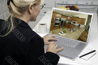 Woman In Kitchen Using Laptop - Home Improvement