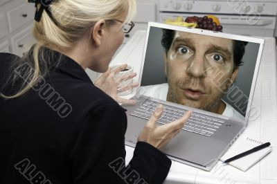 Excited Woman In Kitchen Using Laptop - Intrusion of Privacy