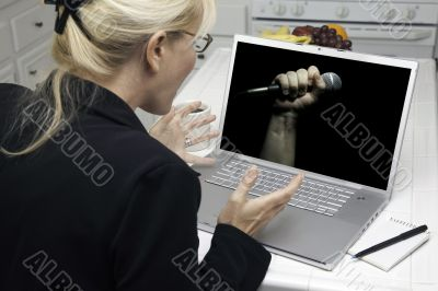 Excited Woman In Kitchen Using Laptop - Freedom of Speech