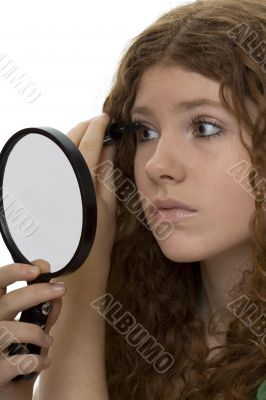 red haired female teenager with mascara