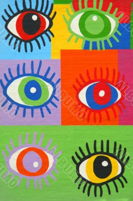 Colorful graffiti spray painted funny eyes on the decorated  bri