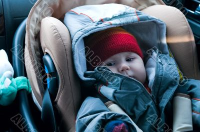 Child in safety car seat