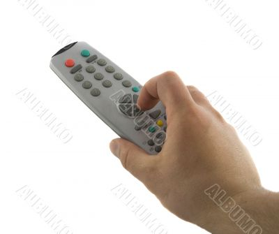 Hand holding a TV remote control isolated over white