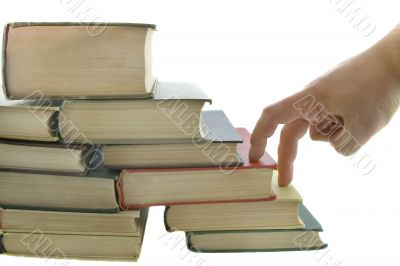 Stack of books and fingers step isolated on the white background