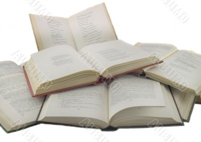 Many open books isolated over white