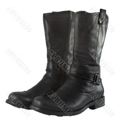 Fashionable  brutal leather male boots on a white background