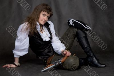 Girl with pistol and pirate hat