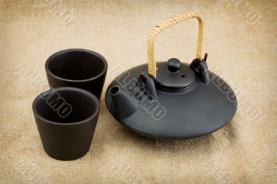 Black ceramic chinese teapot and mugs