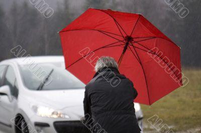red Umbrella at rainy weather