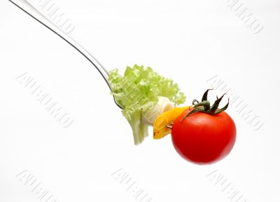 cherry tomato on fork
