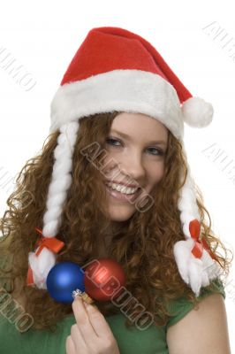 Christmas, red haired teenager with decoration