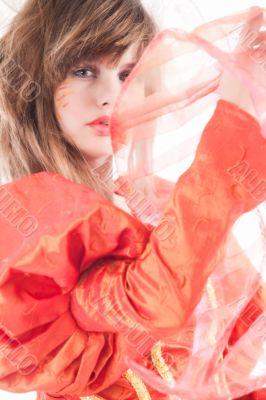 Cute teenage girl showing her orange fancy dress