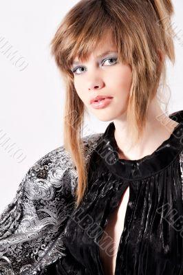 Waist shot of a beautiful teenage girl in classical dress