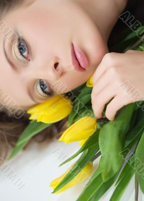 girl beautiful tulips yellow flowers