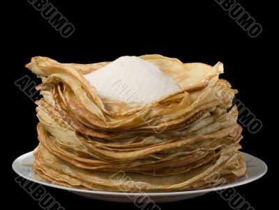 Pancakes and sugar on a plate