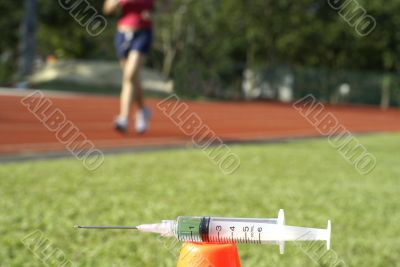 Runner with syringe in foreground