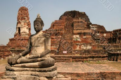 Sitting Buddha in ancient ruins