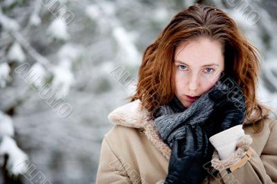 Winter landscape woman enjoying her shawl