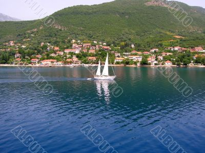 Sailing boat over blue water
