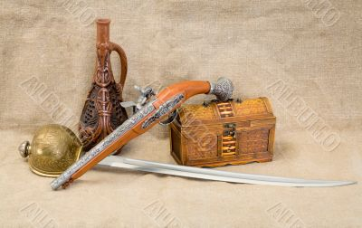 Bottle, rapier, sword, pistol and chest