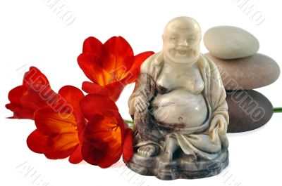 Laughing Buddha, red day-lilies  and stones.