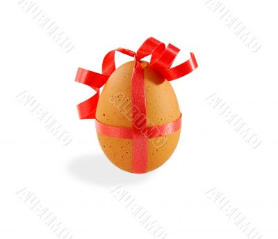 Egg with pink ribbon on white with clipping path.