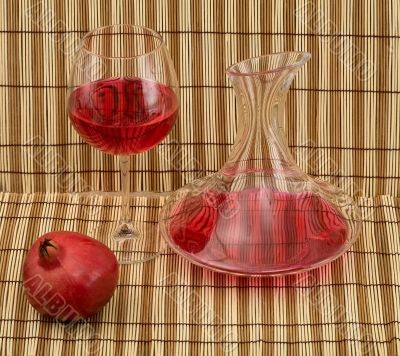 Stil life with decanter, goblet and pomegranate