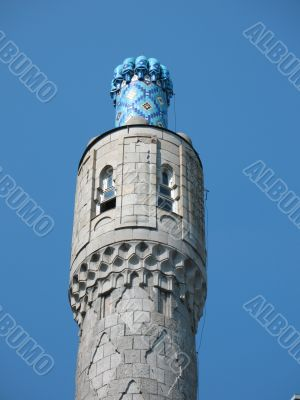 The minaret on the blue sky