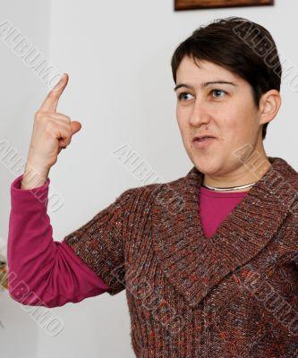 Short-haired woman raising her finger