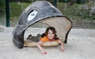 Little girl in the turtle shell