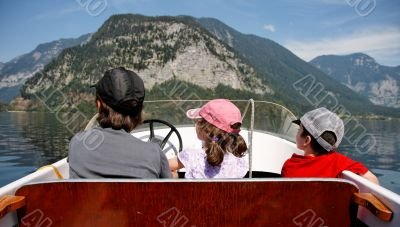 Mother with 2 kids in a motor boat